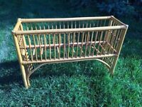 "Rattan fern stand 35"" long 23"" tall"