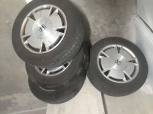 4 rims with tires on