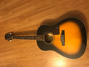 Epiphone Guitar with stand and capo