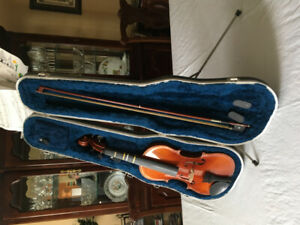 Violin in perfect condition with case, bow and music stand