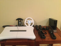CONSOLE WII + WII FIT + 2 MANETTES + 20 JEUX