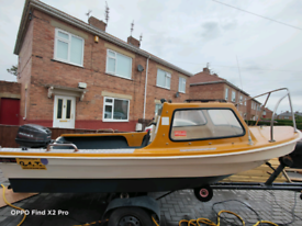 14ft fishing boat ,,20 hp outboard.