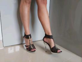 Well worn black stelleto heels size 6.
