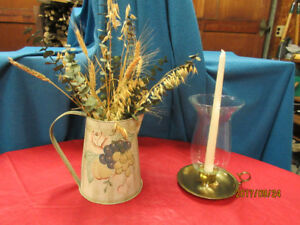 Can with flowers and brass candle holder including candle