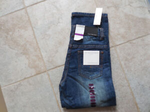 Calvin Klein blue jeans, size 7, brand new tags attached