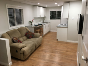 New garden-level furnished 1 bedroom with en-suite laundry