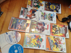Wii games and 3 skylander boxes