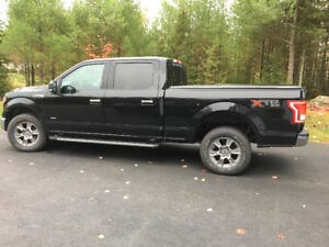 2016 F150 Black equipped to haul fifthwheel