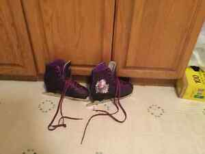 Girls size 6 Hanna Montana figure skates. Purple and sparkly.