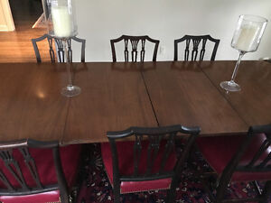 Dining room, long antique pedestal table and 10 matching chairs