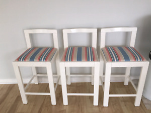 3 white wooden bar stools