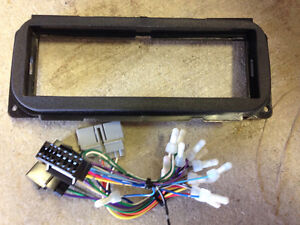 Stereo faceplate and wiring harness adapters for Chrysler