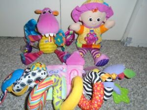 Lamaze baby toys and two other.