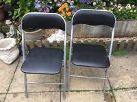 Two metal chairs