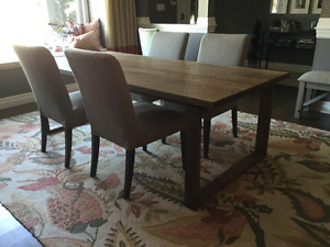 WOOD TABLE AND FOUR UPHOLSTERED CHAIRS