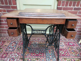 Antique Singer sewing machine treadle table with sewing machine