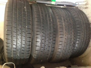 4 car tires with wheels in a good condition
