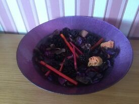 Decorative large bowl with pourri and candle