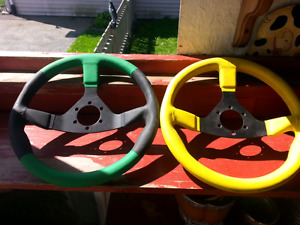 TWO PADED 13 1 / 2 INCH STEERING WHEELS(NEW)$10.00 FIRM FOR BOTH