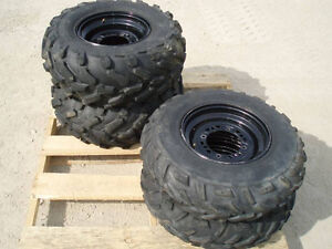 Four used Polaris rims and tires off a 2007 Sportsman 500 HO EFI