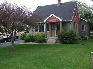 Well-maintained Reddendale home on 11000 square foot lot.
