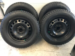 4 pneus d'hiver General Altimax 215/60r16 (Buick Verano Orlando)