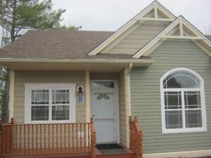 July/Aug 50+ community 2 bdrm cottage setting townhouse (dog OK)