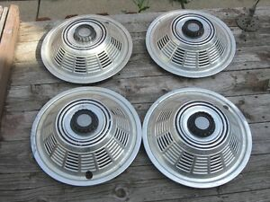 FOUR 16 INCH MATCHING HUB CAPS FOR 16 INCH RIMS