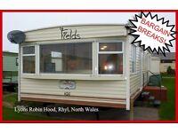HOLIDAY DISCOUNTS! FIELDS: Lyons Robin Hood, Rhyl, N.Wales: 3-bed caravan for holidays