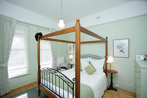 Walnut four poster double bed frame with wrought iron details Preston Darebin Area Preview