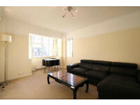 A lovely two bedroom flat in popular building just off Kensington Church Street with lift and porter
