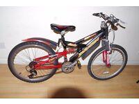 Saracen Teenagers Mountain Bike. 21 speed. 24 inch wheels (Suit: 10 yrs to 14 yrs).