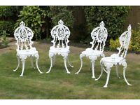 8 matching white cast aluminium garden chairs