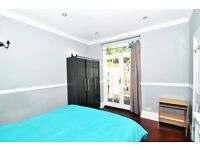 A generously sized double room in Barons Court; ALL BILLS AND WEEKLY CLEANER included, NO DEPOSIT