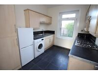 Bathgate town centre. Newly refurbished main door flat with gardens and private off street parking.