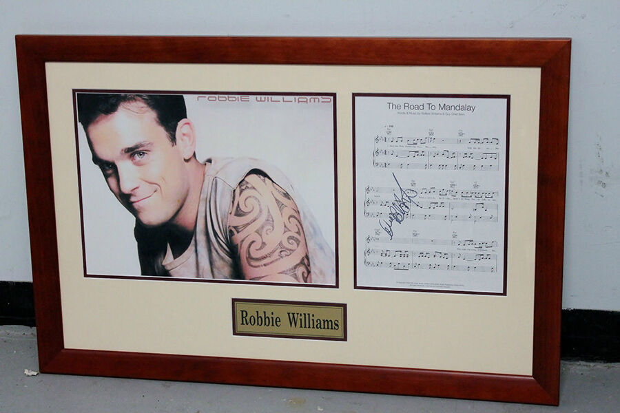 Your Guide to Robbie Williams Signed Products