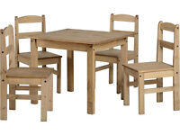 A Maxican pine wooden dining table set with 4 chairs