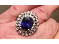 Lovely sapphire and diamond halo ring in 18k gold