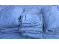 6 duvets, 5 pillows, 2 pillow cases, 2 mattress protectors