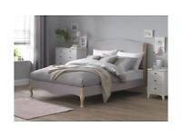 Ex display King size Bed frame. Natural colour fabric. 1/2 shop price. Delivery available.