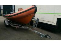 Delta 6.0 M RIB, Dive boat, with Mercury 150HP V6 outboard on galvanised twin axle trailer.