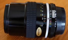 Nikon 135mm f/3.5 AI manual focus lens, 100% mint, and boxed.