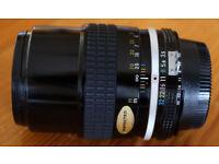 Nikon 135mm f/3.5 AI manual focus lens, 100% mint, and boxed.