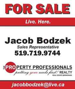 Real Estate Agent; Live. Here.