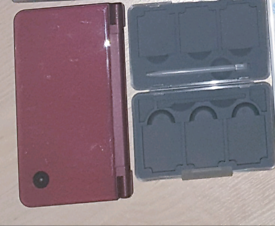 Burgandy Nintendo DSi XL with Games Case & Charger