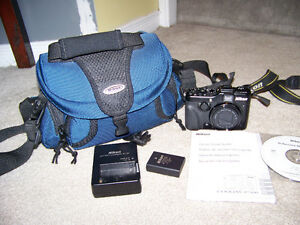 NIKON COOLPIX P7100 DIGITAL CAMERA & BAG