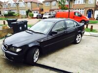 Black BMW 3 series excellent running machine