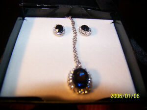 blue sapphirre pendant on silver chain with matching earrings