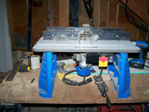 Mastercraft 9.5 A fixed base router and table.