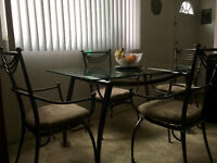 5 ft glass table with 4 pewter-coloured chairs. Edmonton Edmonton Area Preview